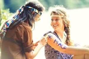 Pretty free hippie girls body painting, vintage effect photo