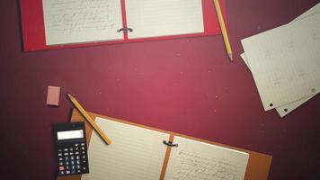 closeup tabela de estudante com caderno e calculadora, fundo escolar