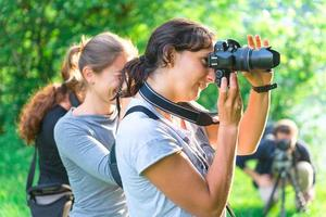 Participants in a photography course outdoors photo