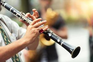 Detail of a street musician playing the clarinet