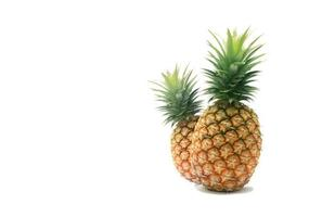 Ripe pineapple isolated on a white background photo