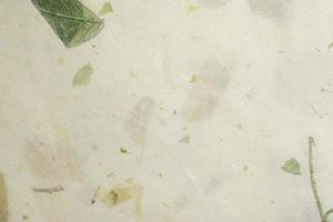 Pale white mulberry paper with leaves texture background photo