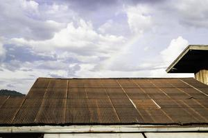 Vintage house roof with a rainbow photo
