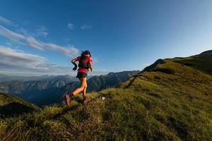 Sporty mountain woman rides in trail during endurance trail photo