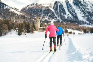 Couple of elderly practices cross-country skiing
