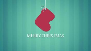 primer plano animado feliz navidad texto y calcetín sobre fondo verde