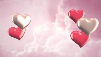 Animation closeup motion petits coeurs romantiques sur fond brillant rose nuageux Saint Valentin
