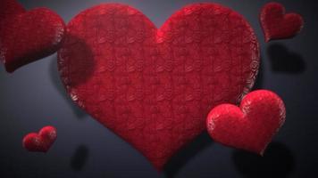 Animation closeup motion grand coeur romantique rouge et petits coeurs sur fond brillant bleu Saint Valentin