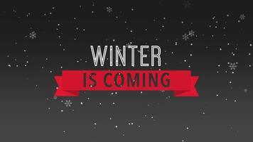closeup animado inverno está chegando texto e flocos de neve brancos voando sobre fundo preto de neve video