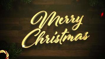 animerad närbild glad jultext, färgglad krans och julgröna trädgrenar på trä video