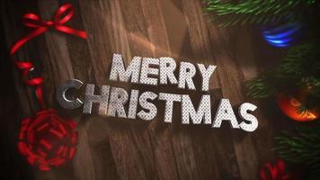 geanimeerde tekst van close-up vrolijke kerst, geschenkdozen en groene boomtakken met ballen op hout