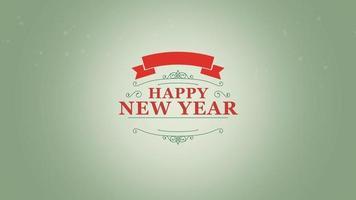 closeup animado texto de feliz ano novo com flocos de neve e carimbo no fundo verde neve video