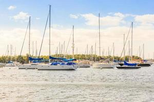 Coconut Grove marina in South Miami Florida in blue sky background photo