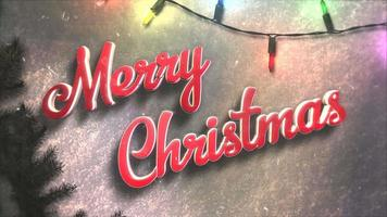 closeup animado texto de feliz natal, guirlanda colorida e galhos de árvores verdes de natal video
