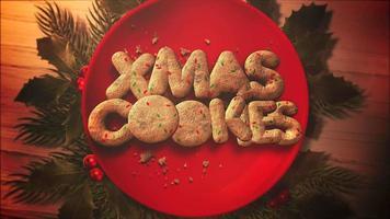 Primer plano animado texto de Navidad, dulces y tarta de Navidad sobre fondo de madera