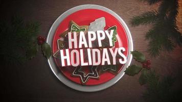 Primer plano animado feliz Navidad texto, dulces y pastel de Navidad sobre fondo de madera