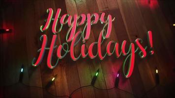 Primer plano animado feliz Navidad texto y guirnalda colorida sobre fondo de madera video