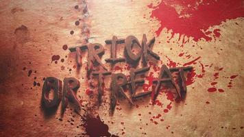 Animación de texto con truco y trato y fondo de terror místico con sangre oscura video