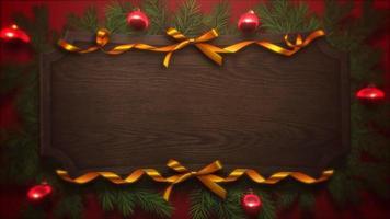 animado close-up bolas vermelhas e galhos de árvores verdes de Natal em fundo de madeira