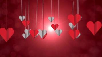 Animation closeup motion small romantic heart on red Valentines day shiny background video