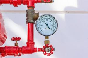 Pressure gauge psi meter in pipe and valves of fire emergency system