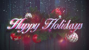 closeup animado texto de boas festas, flocos de neve brancos, ramos verdes de natal em fundo de madeira