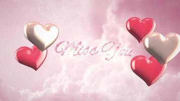 closeup animado sinto sua falta texto e movimento coração romântico no fundo brilhante do dia dos namorados video