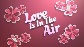 Animated closeup Love is in the Air text and motion romantic heart on Valentine day shiny background video