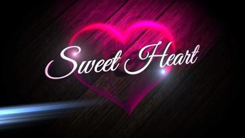 Animated closeup Sweet Heart text and motion romantic heart on Valentine day shiny background video