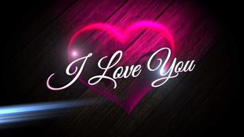 Animated closeup I Love you text and motion romantic heart on Valentine day shiny background video