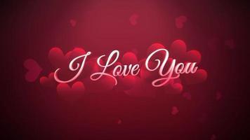 animierte Nahaufnahme Ich liebe dich Text und Bewegung romantisches Herz am Valentinstag glänzenden Hintergrund video