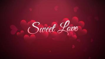 Animated closeup Sweet Love text and motion romantic small red hearts on Valentines day shiny background video