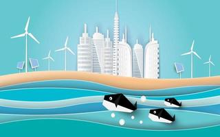 ballenas nadan en el mar con edificios en la playa. estilo de arte de papel. vector