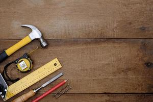 Collection of woodworking handtools on a rough wooden workbench photo