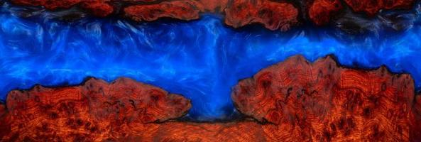 Epoxy resin on a burl wood texture background photo