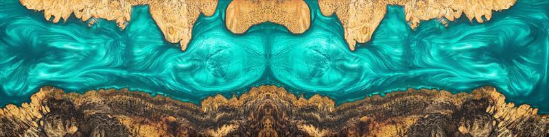 Top view blue of epoxy resin on burl wood photo