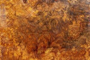 Afzelia burl striped wood texture background photo