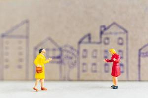 Miniature people staying at home doing self-quarantine to avoid coronavirus, stay home concept
