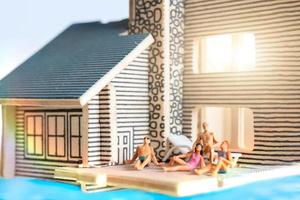Miniature people staying at home doing self-quarantine, stay at home concept photo
