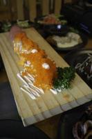 Fish eggs on cutting board photo