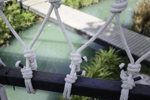 Rope knots holding up a bridge photo