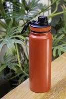 Red thermos for travelling photo