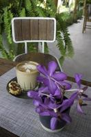 Coffee cup with purple flowers photo