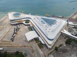 Banten, Indonesia 2021-- Aerial view of Pelabuhan Merak Marine Port and town harbor island photo