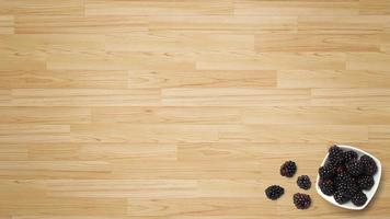 Black Mulberry fruit on wooden background