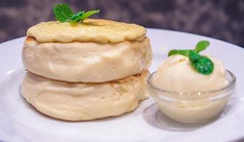 Fluffy Japanese souffle pancakes served with vanilla ice cream photo