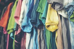 Colorful t-shirts hanging up photo