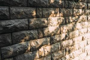 Background stone wall with patches of sunlight photo