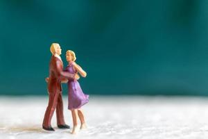Miniature couple dancing on a floor, Valentine's Day concept