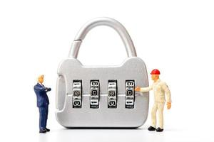 Miniature person working on a combination lock